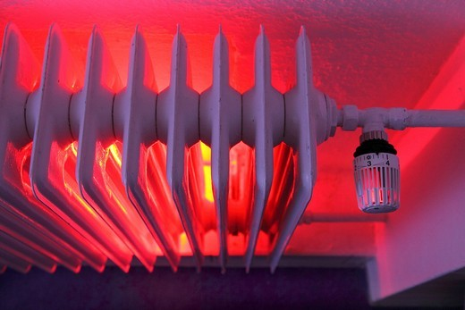 Radiator with thermostat, illuminated, heating costs : Stock Photo
