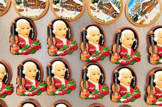 Refrigerator magnets with the image of Wolfgang Amadeus Mozart at a kiosk in the historic town centre of Salzburg, Salzburg, Austria, Europe : Stock Photo