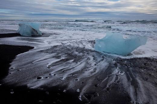 Sea lapping on blocks of ice on the beach, Joekulsarlon, Iceland, Europe : Stock Photo