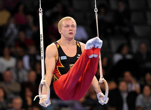 Eugen Spiridonov, GER, on the rings, EnBW Gymnastics World Cup 2010, 28th DTB_Cup, Stuttgart, Baden_Wuerttemberg, Germany, Europe : Stock Photo