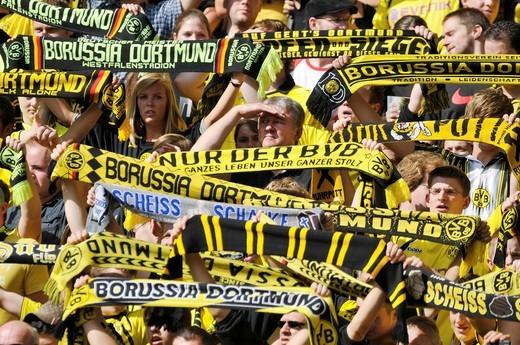 Borussia Dortmund fans with an anti_Schalke scarf, Scheiss Schalke, Bundesliga football league, 3rd matchday, Borussia Dortmund _ VfL Wolfsburg 2:0 : Stock Photo