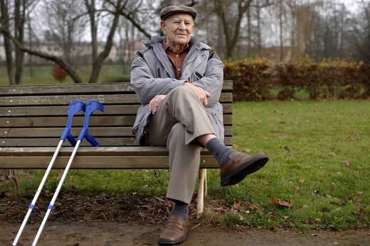 Stock Photo: 1848-541307 Elderly man, senior, 92, on a bench with crutches