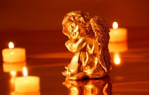 Angel figurine with candles : Stock Photo