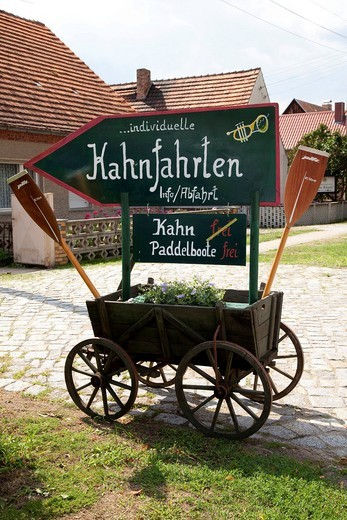 Wooden cart with sign advertising boat rides, Schlepzig, Spreewald, Spree Forest, Brandenburg, Germany, Europe : Stock Photo