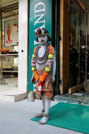 A child dressed as Lord Krishna going begging, Delhi, Uttar Pradesh, North India, India, Asia : Stock Photo