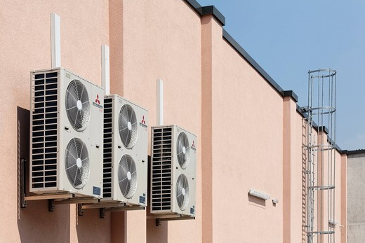 Outdoor units of split_system air conditioners at a supermarket, Duesseldorf, North Rhine_Westphalia, Germany, Europe : Stock Photo