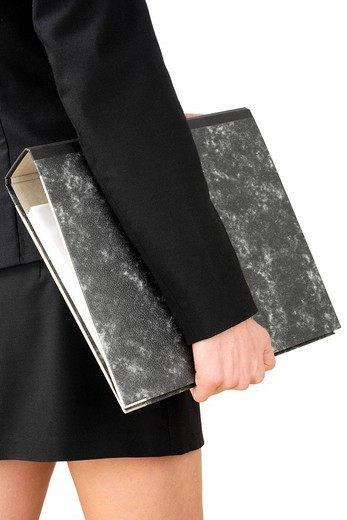 Stock Photo: 1848-54217 Woman holding binder under her arm