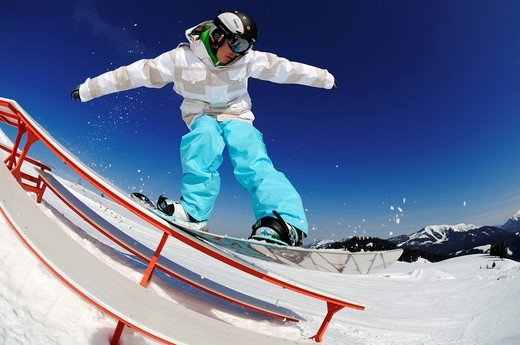 Snowboarder, fun park, ski resort of Reit im Winkl, Chiemgau, Upper Bavaria, Germany, Europe : Stock Photo