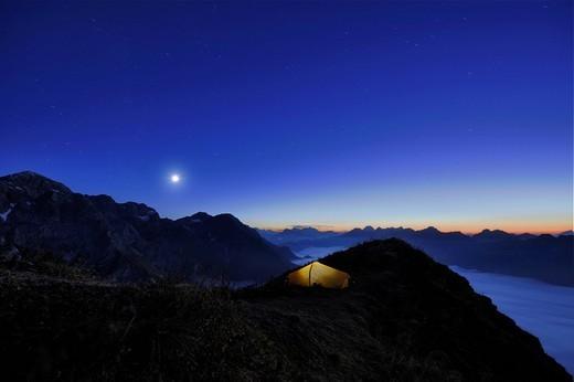 Tent on a peak af the blue hour, Allgaeu Alps, Kleinwalsertal valley, Vorarlberg, Austria, Europe : Stock Photo