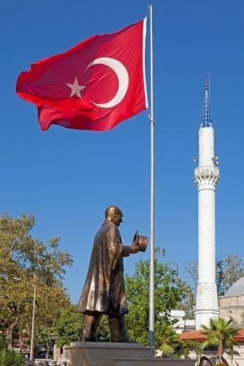 Stock Photo: 1848-543926 Ataturk statue, minaret, flag, Dalyan, Dalyan Delta, Turkish Aegean, Turkey