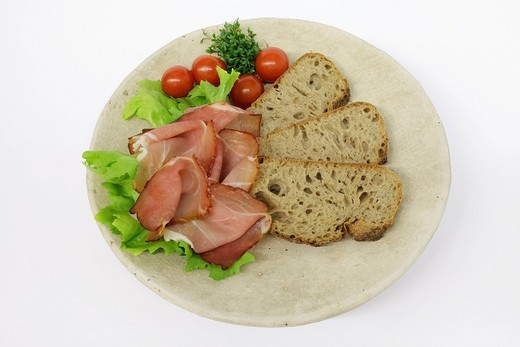 Stock Photo: 1848-544091 Black Forest smoked ham with bread and cherry tomatoes