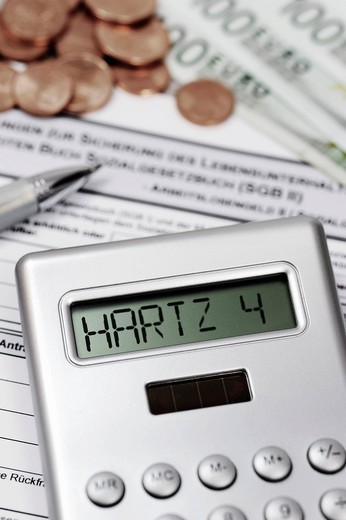 Calculator with Hartz IV lettering and an ALG II application form : Stock Photo