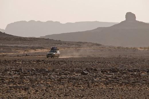 Off_road vehicle in rock landscape, Tasset, Algeria, Africa : Stock Photo
