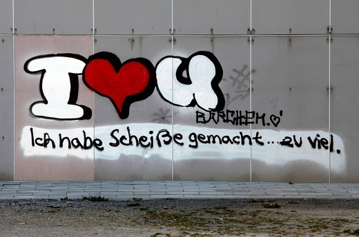 Graffiti on a building, written apology in German for a mistake made in a love relationship : Stock Photo