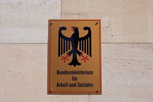 Sign with the federal eagle, Federal Ministry of Labour and Social Affairs, Berlin, Germany, Europe : Stock Photo