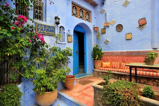 Front door of a house with a sitting area and plants, Chefchaouen, Reef Mountains, Morocco, Africa : Stock Photo
