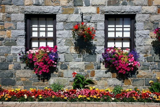 Typical Guernsey house made from solid stone and granite, with many flowers and plants, Guernsey, Channel Islands, Europe : Stock Photo