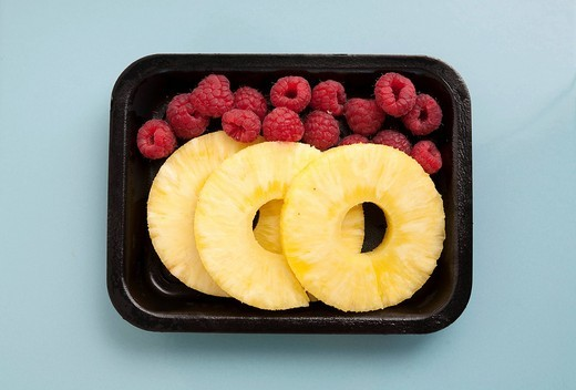 Stock Photo: 1848-547315 Packaged pineapple slices and raspberries