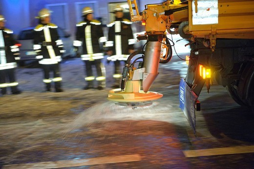 Winter services scattering salt on the road, ice hazard through water used for for firefighting, Kirchheim unter Teck, Baden_Wuerttemberg, Germany, Europe : Stock Photo