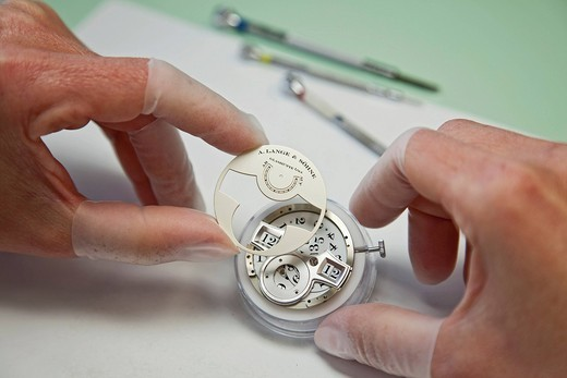 Stock Photo: 1848-548482 Watch manufacturer in in Lange and Soehne GmbH, workplace for the assembly of chronometers, inspection of the Lange mechanism, Glashuette, Saxony, Germany, Europe