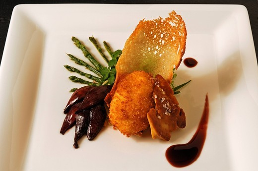 Roasted duck liver with poached baked egg, wild asparagus and red onion confit served on a white plate, food, haute cuisine : Stock Photo