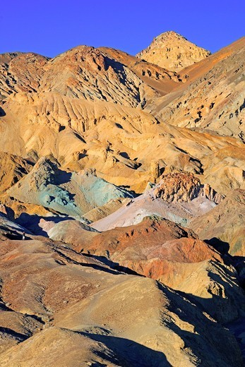 Rock colours caused by the oxidation of different metals, Artist´s Palette at dusk, Death Valley National Park, California, USA, North America : Stock Photo