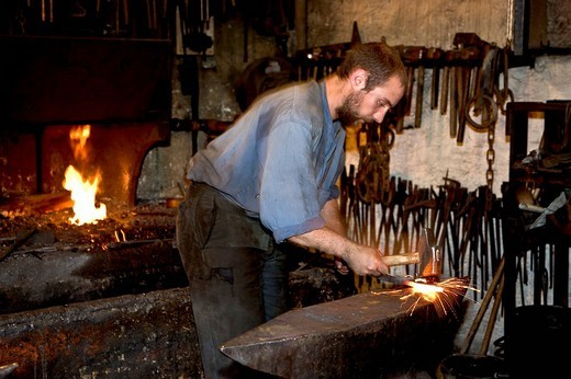 Working blacksmith at the Écomusée d'Alsace, Alsace, France : Stock Photo