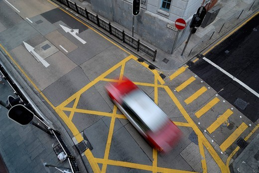 Stock Photo: 1848-549983 Taxi speeding across an intersection in Soho district, Central district, Hong Kong, China, Asia