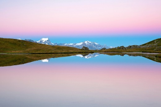 Stock Photo: 1848-550034 Early morning mood on Lake Berglimatt with a reflection of the Glarus Alps, Canton of Glarus, Switzerland, Europe