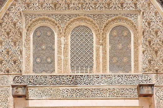 Elaborate stucco ornaments, arabesques and Koranic verses made of plaster at the Medersa Bou Inania Koran School, Fez, Morocco, Africa : Stock Photo