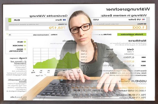 Woman surfing the internet on a computer, web page with currency converter, view from the monitor : Stock Photo