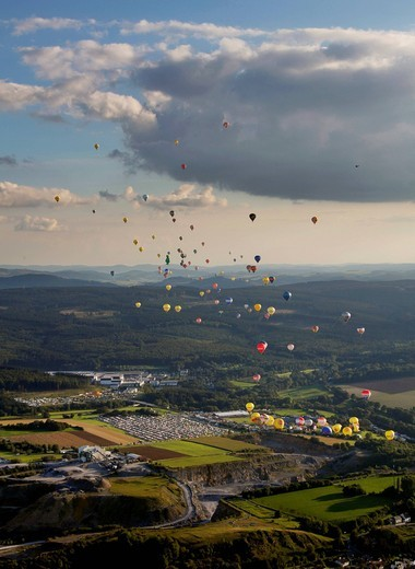 Aerial view, 20th Warsteiner Montgolfiade, hot_air_balloon festival with nearly 200 hot_air_balloons ascending into the sky, Warstein, Sauerland, North Rhine_Westphalia, Germany, Europe : Stock Photo