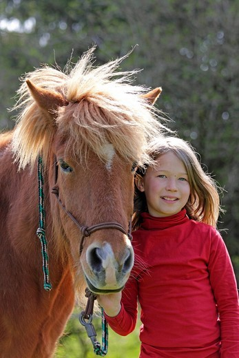 Little girl with a pony : Stock Photo
