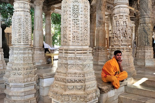 Stock Photo: 1848-552282 Young monk wearing the traditional yellow monk´s robe in the inner hall with ornate marble pillars in the Temple of Ranakpur, a temple of the Jain religion, Rajasthan, North India, India, Asia