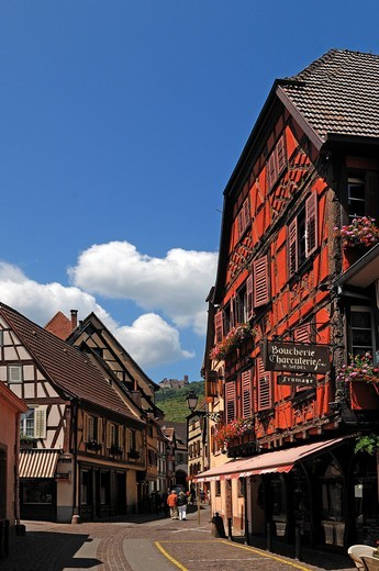 Stock Photo: 1848-552619 Main street with old Alsatian half_timbered houses, in the distance, the ruins of Ulrichsburg Castle, Grand´Rue, Ribeauvillé, Alsace, France, Europe