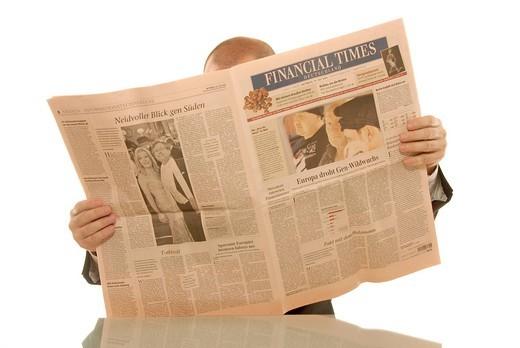 Stock Photo: 1848-553445 Businessman reading a German business newspaper