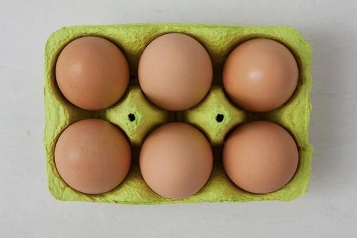 Stock Photo: 1848-554866 Six brown eggs in an egg carton