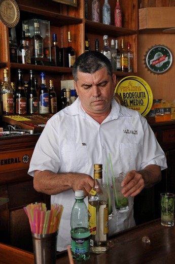 Stock Photo: 1848-554885 Bartender mixing a Mojito cocktail with rum, mint and lime, La Bodeguita del Medio, Empedrado 207, old town, Havana, Cuba, Caribbean, Central America