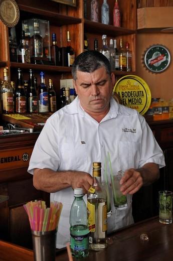 Bartender mixing a Mojito cocktail with rum, mint and lime, La Bodeguita del Medio, Empedrado 207, old town, Havana, Cuba, Caribbean, Central America : Stock Photo