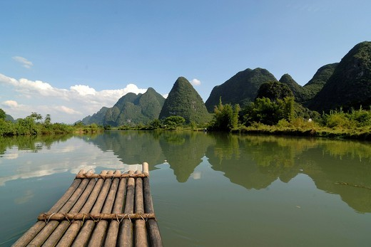 Bamboo raft on the Yulong river in the karst landscape near Yangshuo, Guilin, Guangxi, China, Asia : Stock Photo