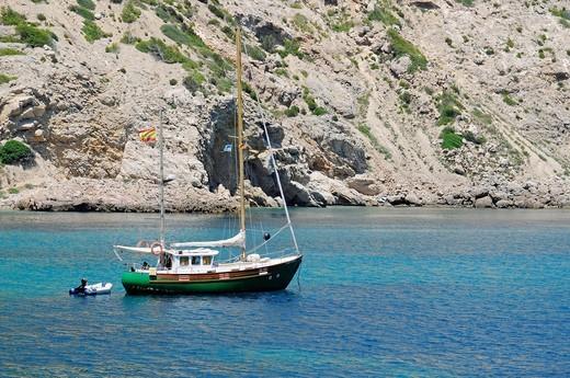 Stock Photo: 1848-555394 Sailboat alone in a bay, Cala Llonga, rocky coast, Santa Eulalia des Riu, Ibiza, Pityuses, Balearic Islands, Spain, Europe