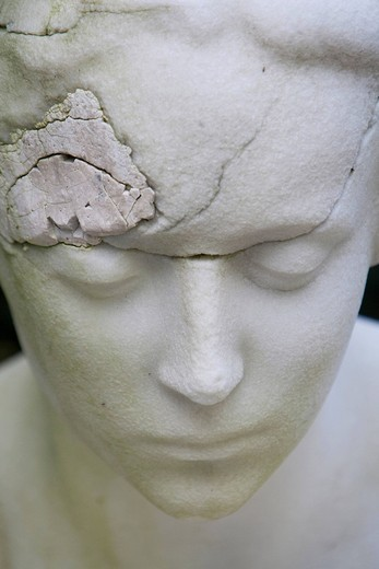 Cracked face of a cemetery statue, portrait, woman : Stock Photo