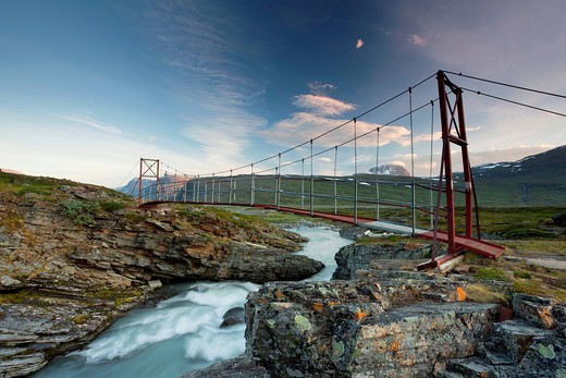 Midnight sun and an old suspension bridge in the Tjaekta Valley, Kungsleden, The King´s Trail, Lapland, Sweden, Europe : Stock Photo