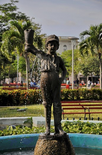 Fountain, child holding a boot, Park Vidal, old town of Santa Clara, Cuba, Caribbean, Central America : Stock Photo