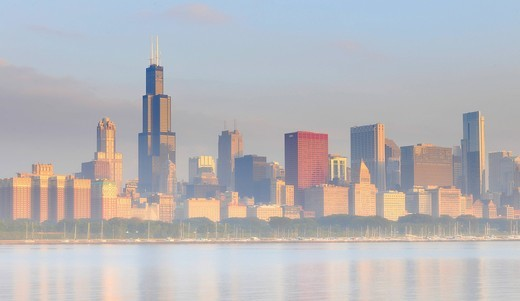 Foggy atmosphere after sunrise, 311 South Wacker, Aon Center, 77 West Wacker Drive, Legacy at Millennium Park, CNA Center, skyscrapers on the skyline, Lake Michigan, Chicago, Illinois, United States of America, USA : Stock Photo