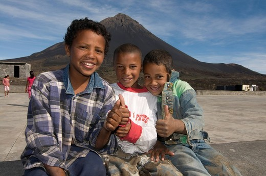 Stock Photo: 1848-558843 Smiling boys in front of volcano on Fogo, Cabo Verde, Africa