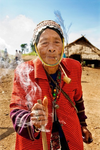 Stock Photo: 1848-559145 Old Akha hill tribe woman smoking a pipe in the hills of north Thailand, Asia