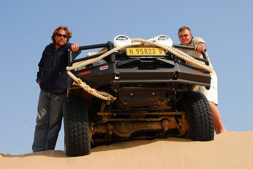 Stock Photo: 1848-55924 Two men with Jeep on a dune at Conception Bay, Diamond Area, Namibia
