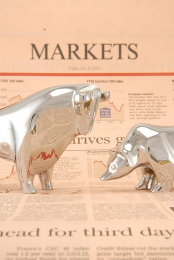 Bull and a bear standing on a financial newspaper, symbolic image for stock market : Stock Photo