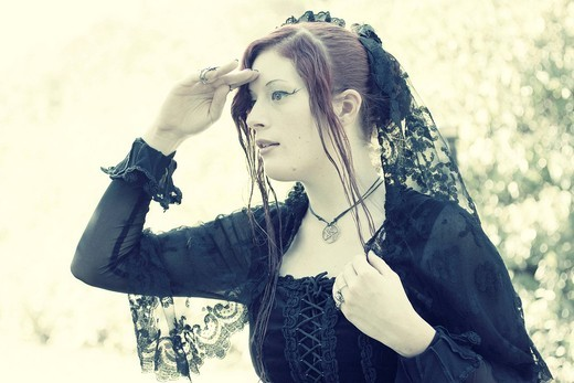 Red_haired woman, gothic looking into the distance : Stock Photo